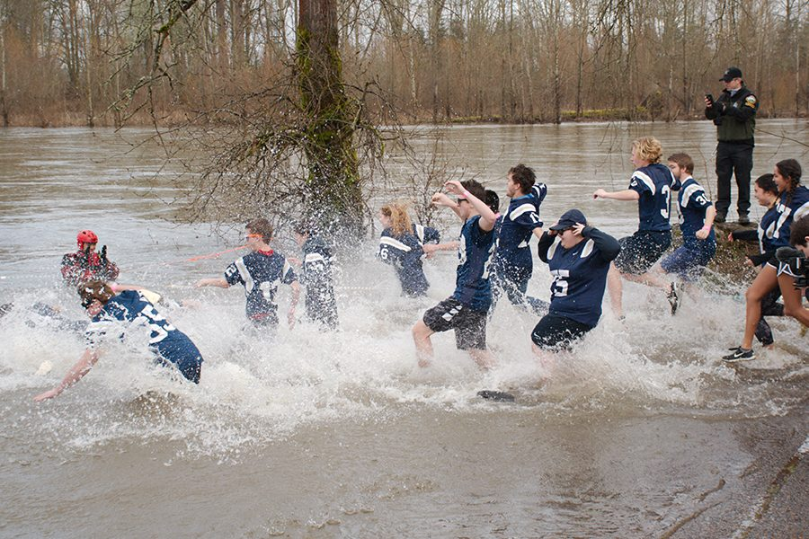 West Albany students charge into the frigid Willamette River at the 2017 Corvallis Polar Plunge. The Plunge is an annual fundraiser for Special Olympics Oregon.