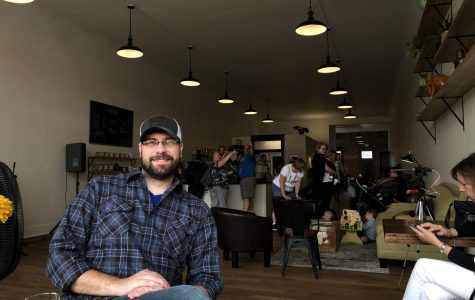 Jon Eick, former West Albany staff member, sits in front of Margin Coffee's living space on a busy Saturday