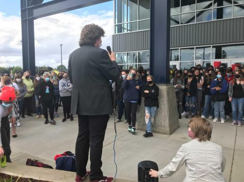 Junior Andy Craig gives a speech to students protesting the schedule change